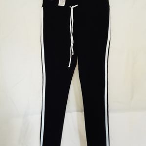 Black comfy sweats with white stripe on the side.